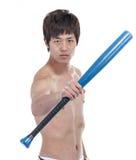 Young man with baseball bat Stock Image
