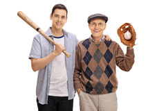 Young man with a baseball bat and a senior with a glove. Young men with a baseball bat and a senior with a glove isolated on white background Royalty Free Stock Photography
