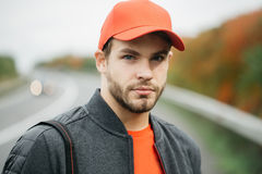 Young man in baseball cap Stock Images