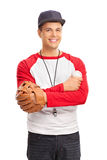 Young man with a baseball glove holding a baseball Stock Photography