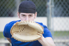 Young man with baseball glove Stock Images