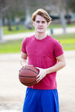 Young man with basketball Royalty Free Stock Images