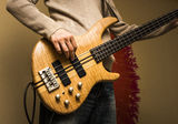 Young man with a bass guitar, front view Royalty Free Stock Images