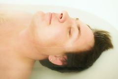 Young man in bath Royalty Free Stock Image