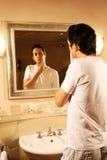Young man in bathroom Stock Photos