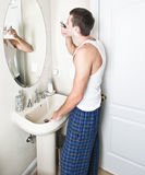 Young Man in Bathroom Shaving Royalty Free Stock Photos