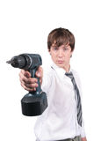 Young  man in with battery drill. Young  man in office clothes with battery drill isolated on white Royalty Free Stock Photography