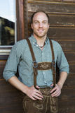 Young man in bavarian lederhosen Royalty Free Stock Photos