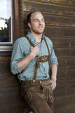 Young man in bavarian lederhosen Royalty Free Stock Photo