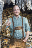 Young man in bavarian lederhosen with thumbs up Royalty Free Stock Photos