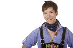 Young man in Bavarian Oktoberfest leather trousers Royalty Free Stock Images