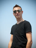 Young man at the beach. Handsome Young man at the beach Royalty Free Stock Image