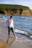 Young man at the beach Royalty Free Stock Photo