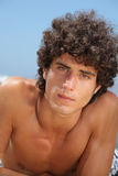 Young man on the beach Stock Photography