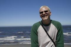 Young man at the beach Stock Photos