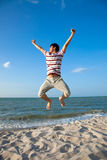 Young man by the beach. Excited young man having fun at beach Stock Photo