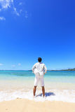 Young man on beach Stock Photo