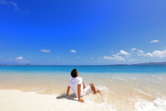 Young man on beach Royalty Free Stock Photos