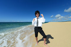 Young man on the beach enjoy sunlight Stock Photos