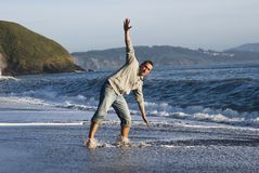 Young man beach fun Stock Photography