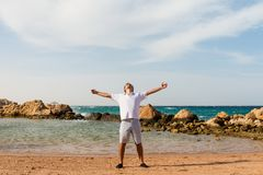Young man at the beach Stock Photography