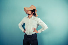 Young man with a beach hat Stock Photography