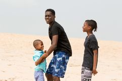 Young man at the beach with his family royalty free stock photography