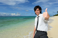Young man on beach Royalty Free Stock Photography