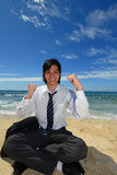 Young man on beach Stock Photos