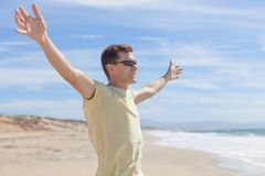 Young man at the beach Stock Image