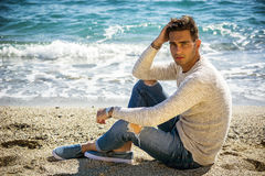 Young Man on a Beach in a Sunny Summer Day Royalty Free Stock Photo