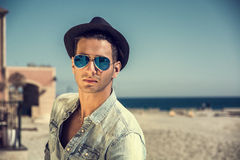 Young Man at Beach in Sunny Summer Day Stock Photography