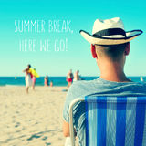 A young man on the beach and the text summer break, here we go Stock Image