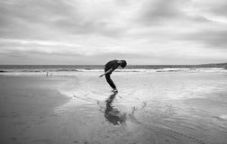 Young man on a beach royalty free stock photo