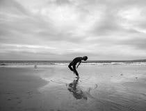 Young man on a beach stock photos