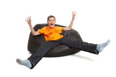 Young man on bean bag. Isolated on white royalty free stock images