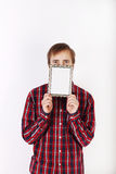 Young man with beard in checkered red shirt hides his mouth Stock Images