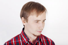 Young man with beard in checkered red shirt Stock Photography