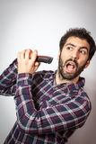 Young man with beard dont't want cut it Royalty Free Stock Photo