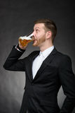 Young man with beard drinking beer Royalty Free Stock Images