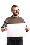 Young man with beard holding blank board Stock Photo