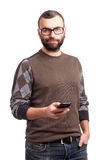 Young man with beard holding cell phone Stock Images