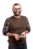 Young man with beard holding photo camera Stock Photography
