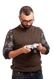 Young man with beard holding photo camera Stock Photo