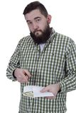 Young man with a beard. Holds money royalty free stock photography