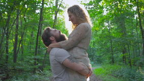 Young man with a beard hugging his girlfriend in wood stock video