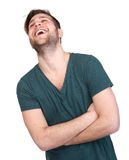 Young man with beard laughing Royalty Free Stock Image