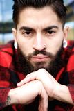 Young man with beard and piercing Royalty Free Stock Photography