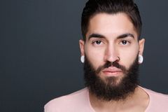 Young man with beard and piercings Stock Photos