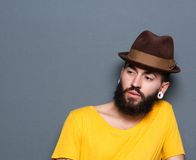 Young man with beard and piercings wearing hat Stock Image